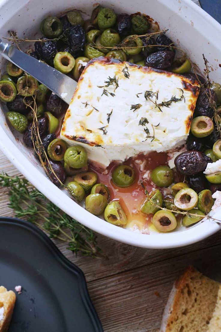 Baked Feta with Olives, Thyme & Honey #datteldip Baked Feta with Olives Thyme & Honey is your new favorite appetizer! Perfect for date night in or for when you have guests.
