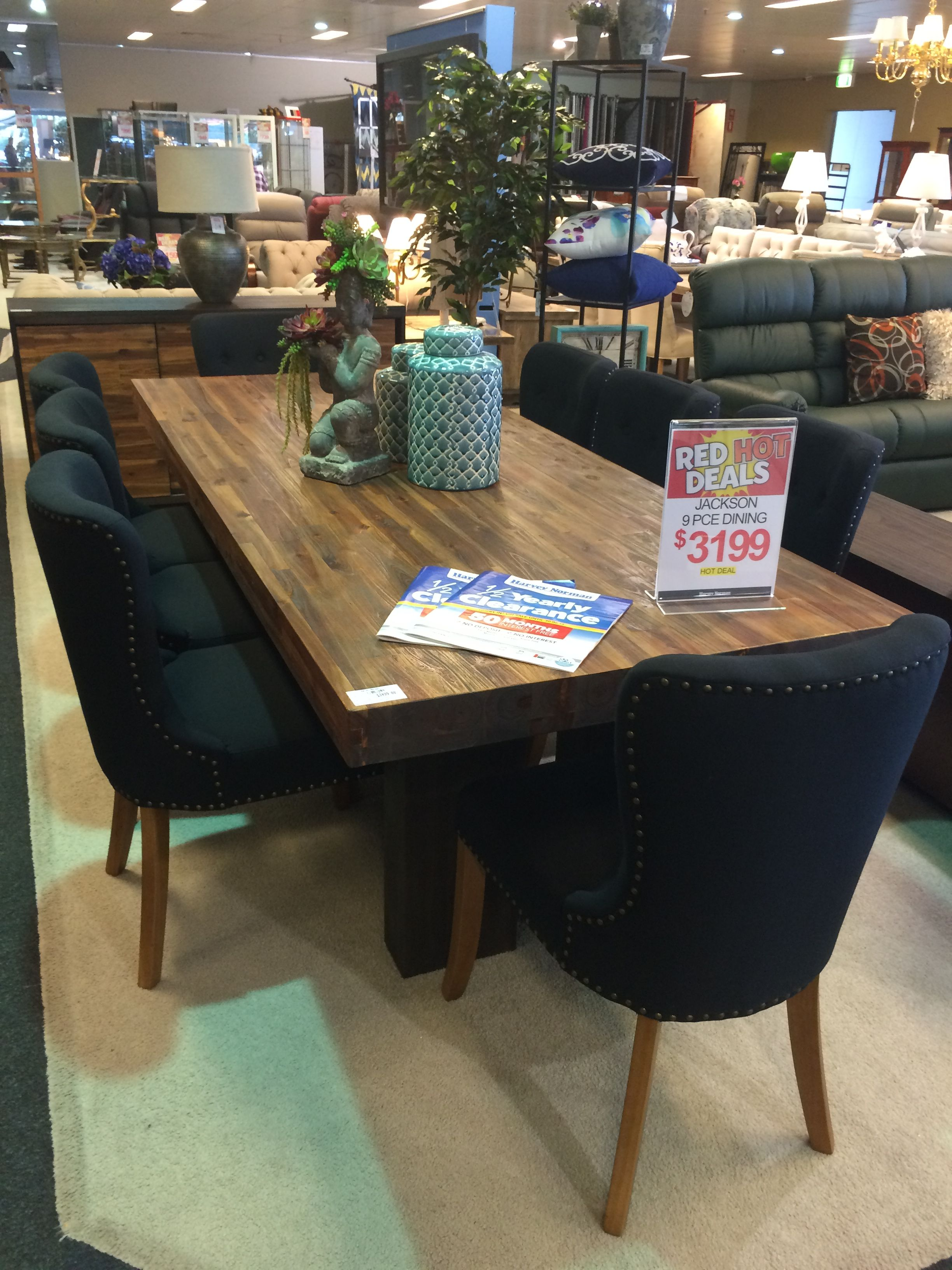 Farmhouse dining table. Black studded chairs. From Harvey ...