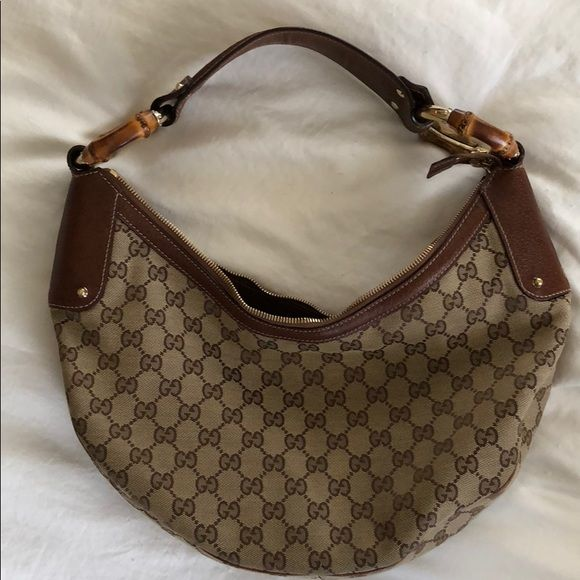 b2070c8f657ac9 Gucci handbag Authentic over the shoulder Gucci bag, with wooden handles.  Comes in original Gucci flannel bag. Gucci Bags Shoulder Bags