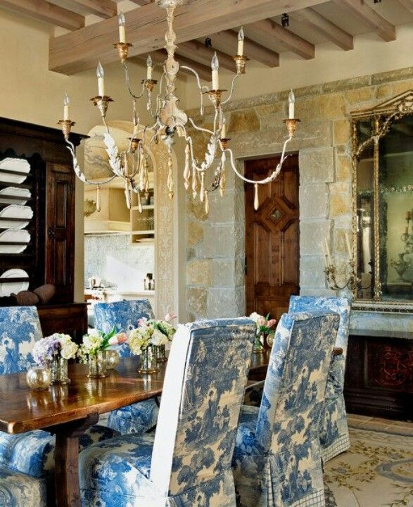Patterned slips; white, airy chandelier.  There is an inexpensive version of this chandy on Lamps Plus.