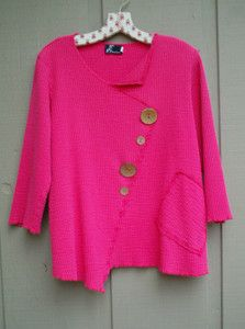 Love the bright color, the  irregular lines and the mismatched buttons