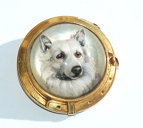 A Reverse Intaglio Crystal Of A Husky Dog Set To A High Carat