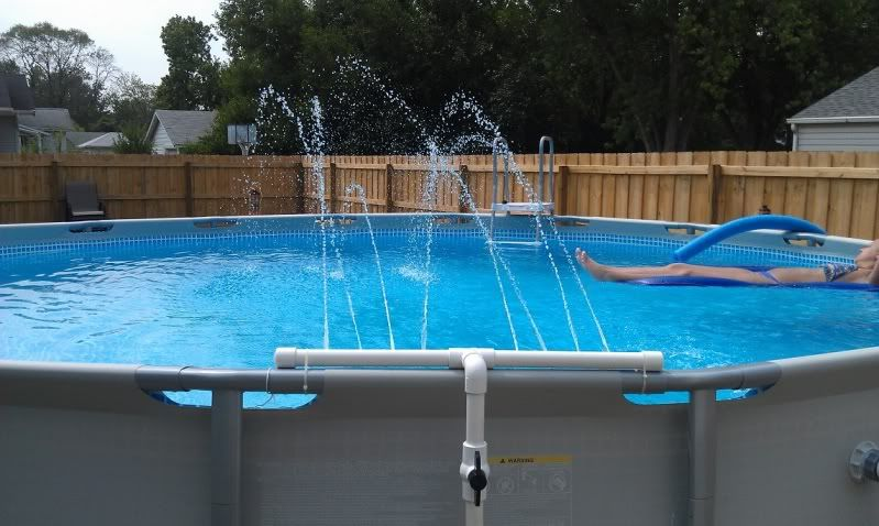 Above ground pool water falls above ground pool for Garden swimming pools below ground
