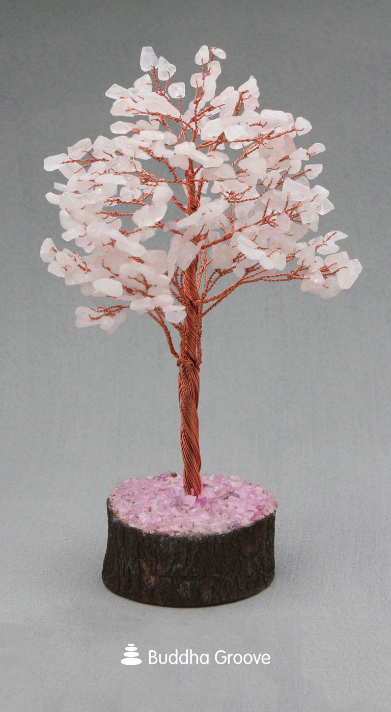Tufts Of Pink Sprout From All Over This Tree S Branches Just Like Flowering Cherry Blossoms These Cherry Blossom Tree Gemstone Healing Rose Quartz Gemstone