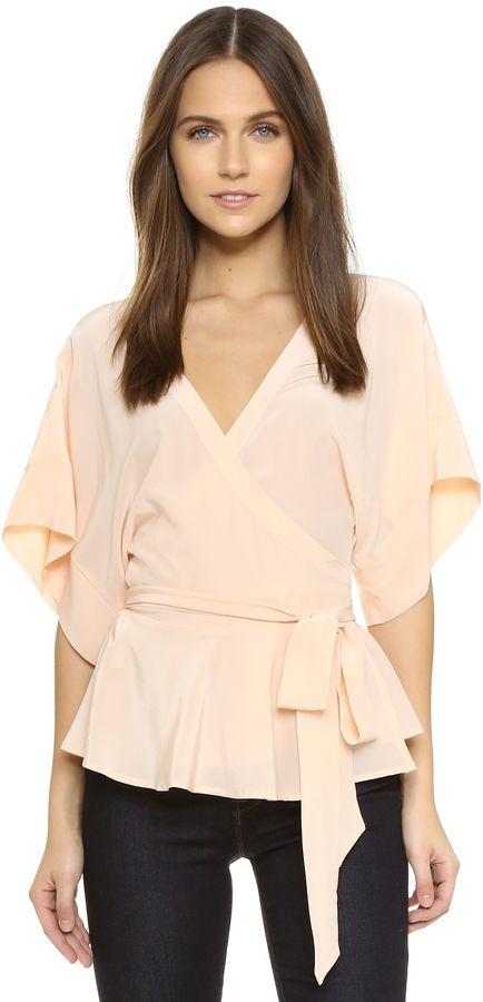 fe4098da21f A ruffled hem lends a feminine feel to this kimono-inspired Yumi Kim wrap  top.