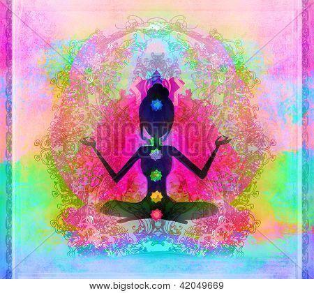yoga lotus pose padmasana with colored chakra points
