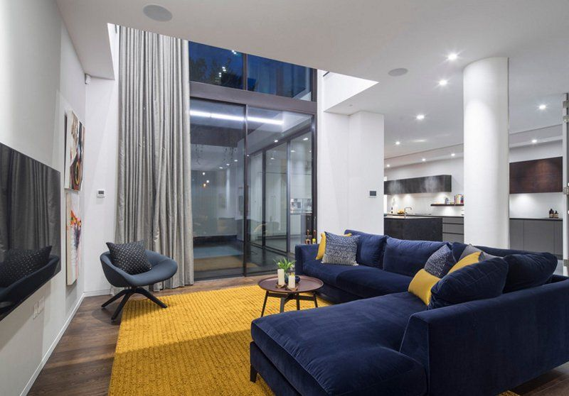20 Appealing Living Rooms With Gold And Navy Accents Home Design Lover Yellow Decor Living Room Blue Sofas Living Room Blue Living Room Decor
