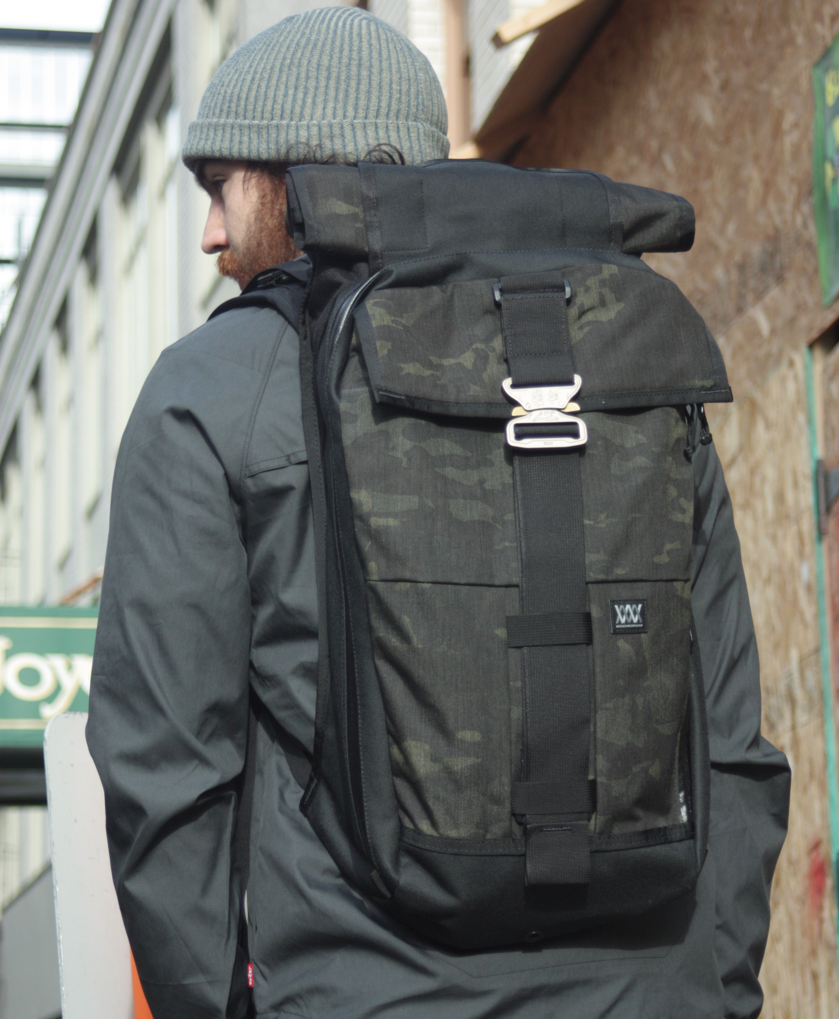 The US made Limited Edition black camo Rambler expandable backpack from Mission Workshop comes with a fine looking buckle from Austrian manufacturer AustriAlpin. These are some of the most versatile bags we've come across, able to expand from 22 to 44 liters!