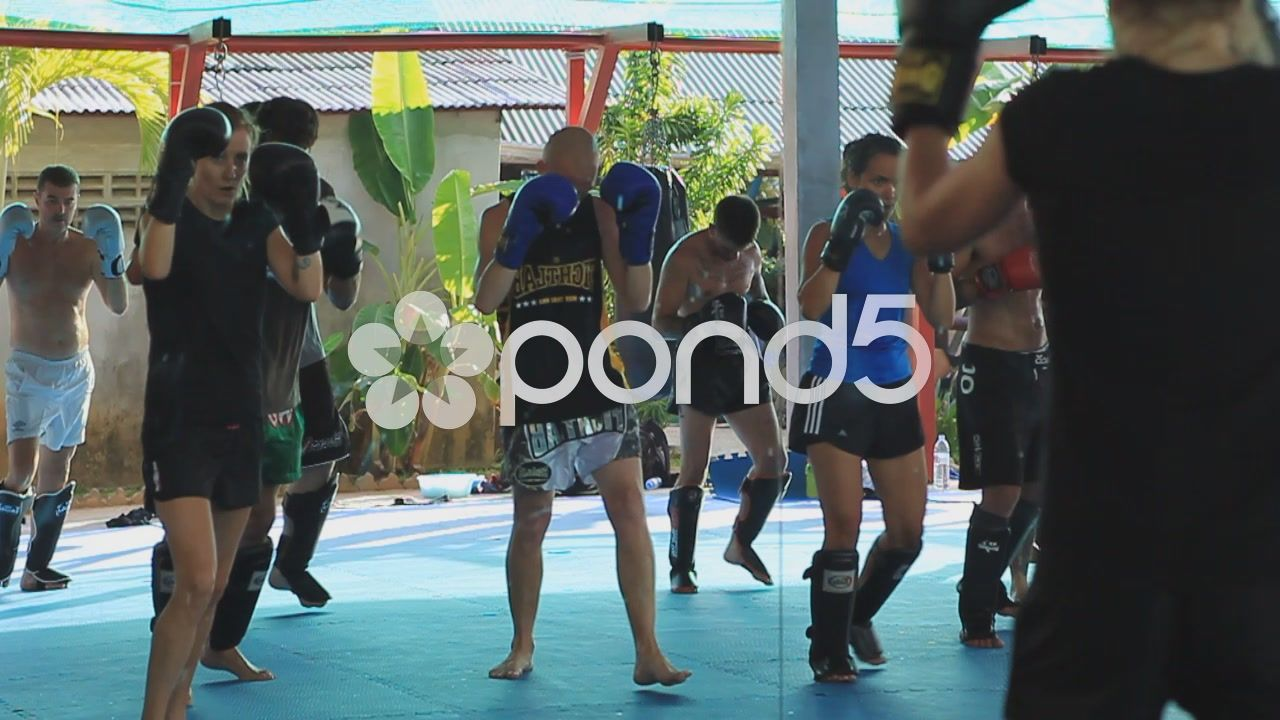 Muay thai boxing class training practise reflection in
