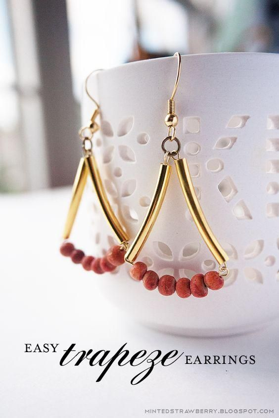 Red wooden beads and golden bugle beads dangle earrings