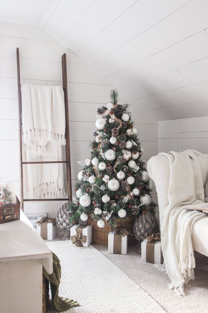 a beautiful farmhouse bedroom decorated for the holidays