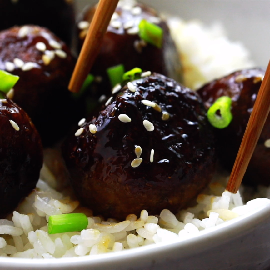 These Vegan Teriyaki Meatballs have the perfect texture and taste divine! They are incredibly easy to make, coated in a homemade sweet and sticky teriyaki sauce and so meal preppable! #homemadesweets