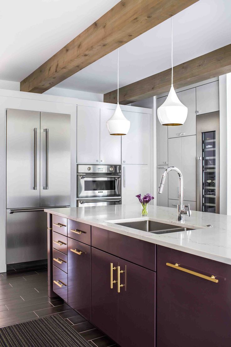 Plum kitchen cabinets? Yes, please! The gold hardware pops ...