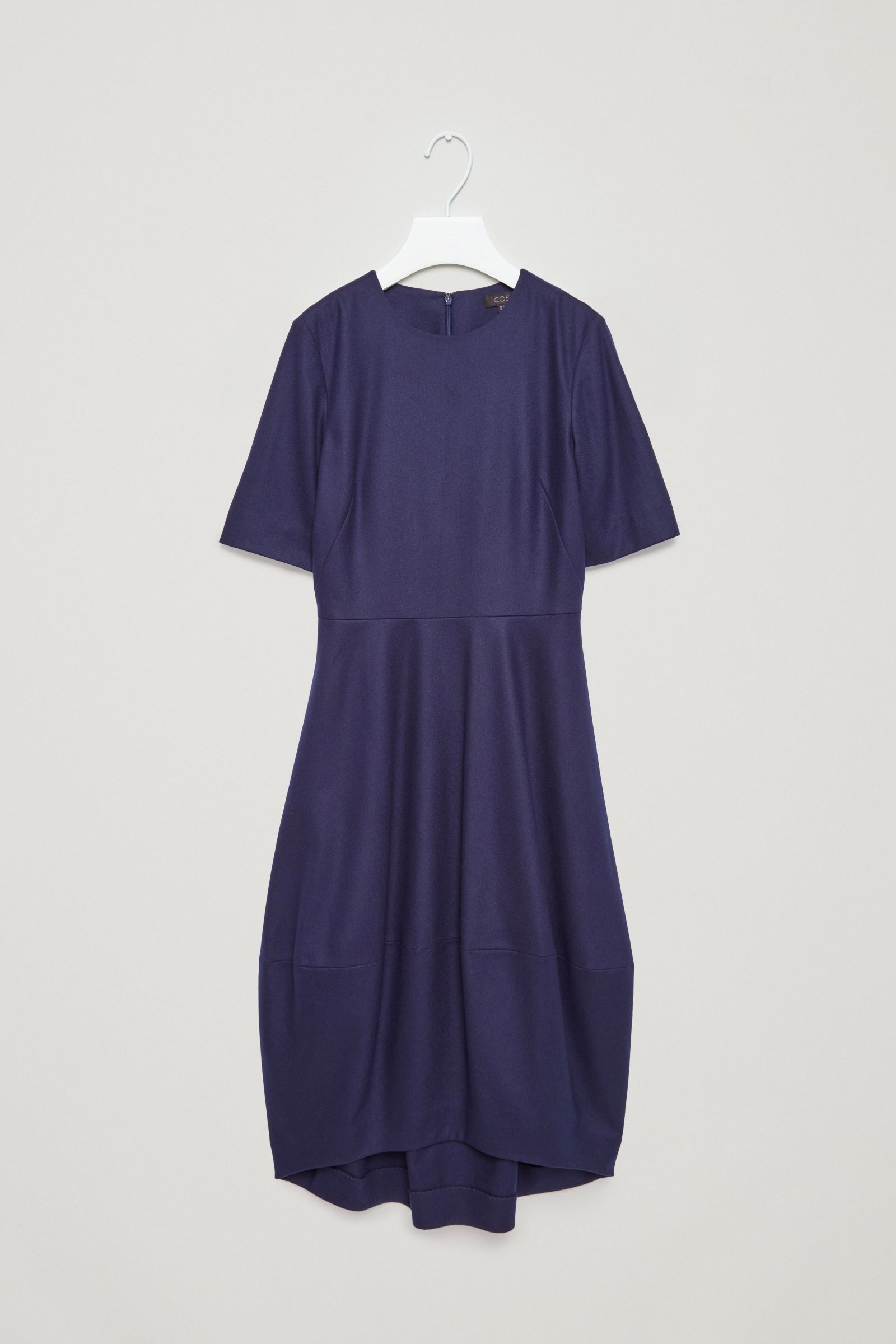 This dress is made from smooth woolmix with a cocoon shape