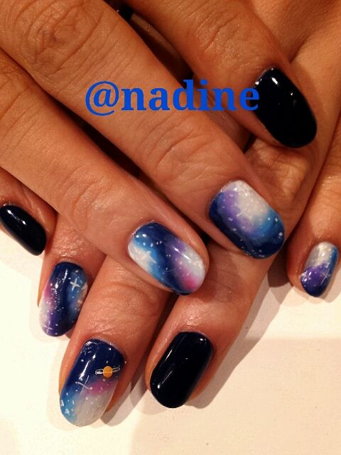 I love the black nails separating the galaxies- makes them pop!