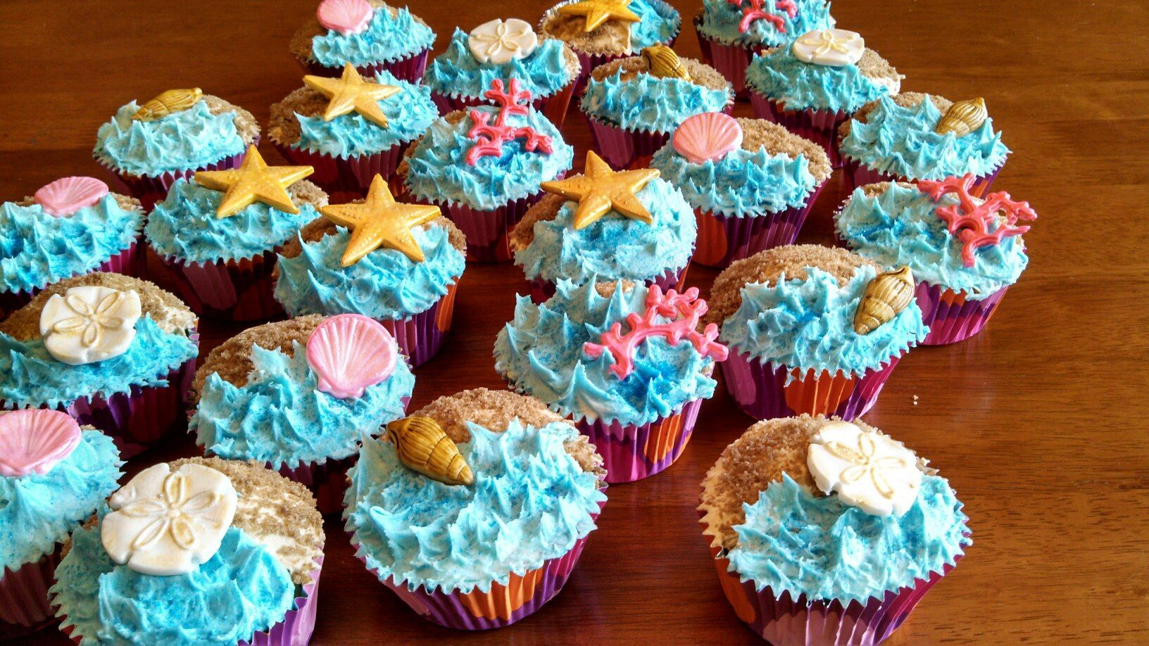 Beach and ocean cupcakes with shells sand dollars coral