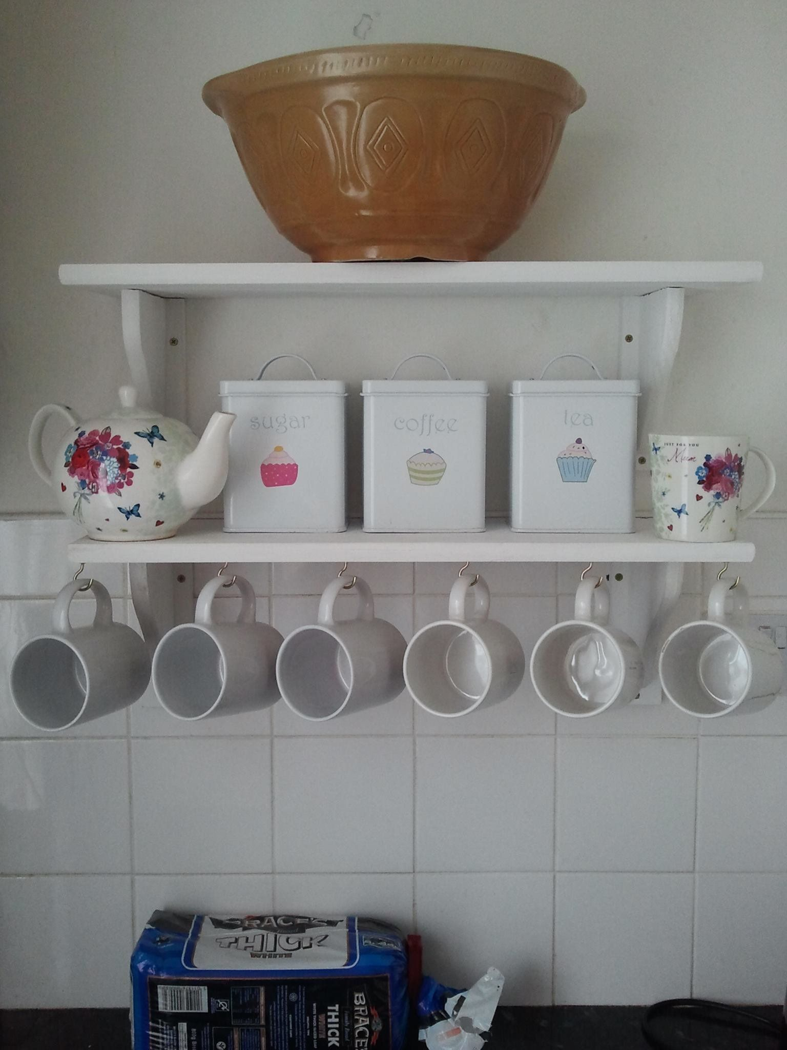 Painted pine shelves with cup hooks.