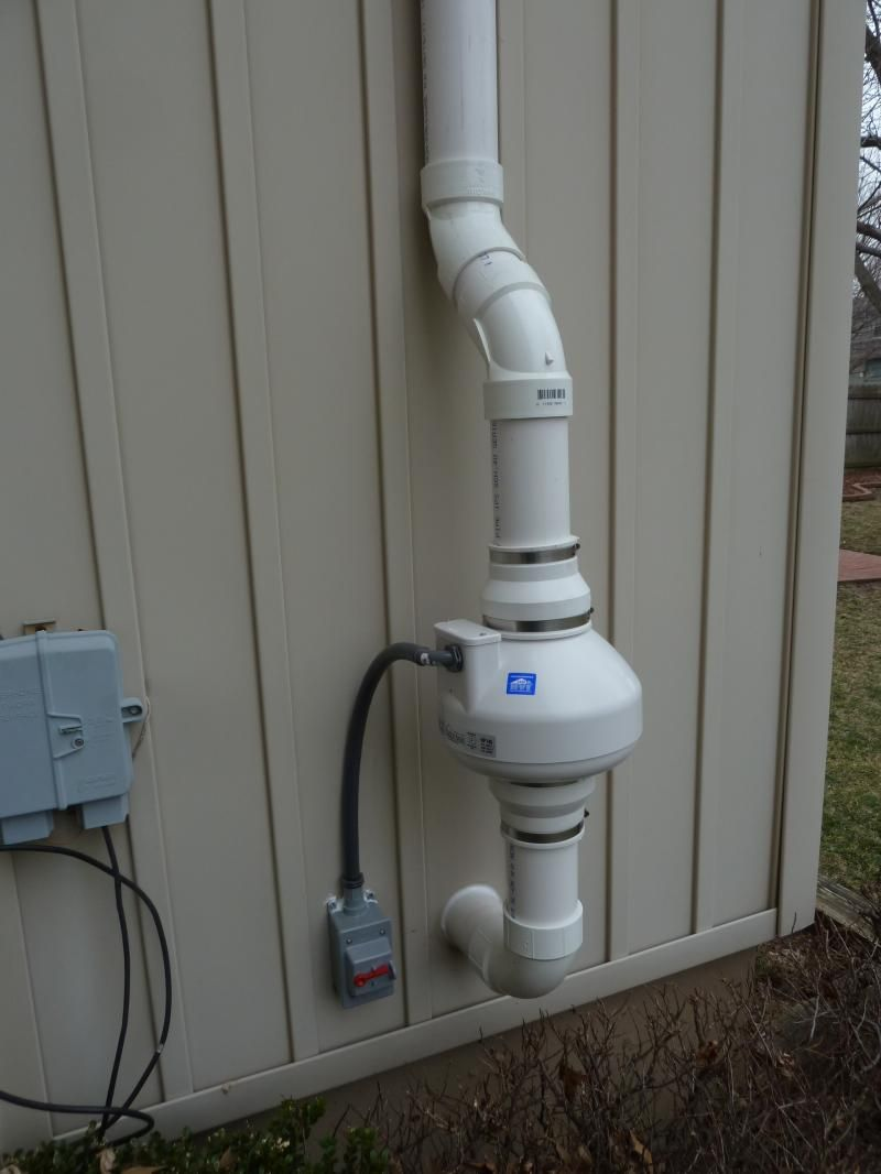 radon fan and required disconnect switch on home exterior | home