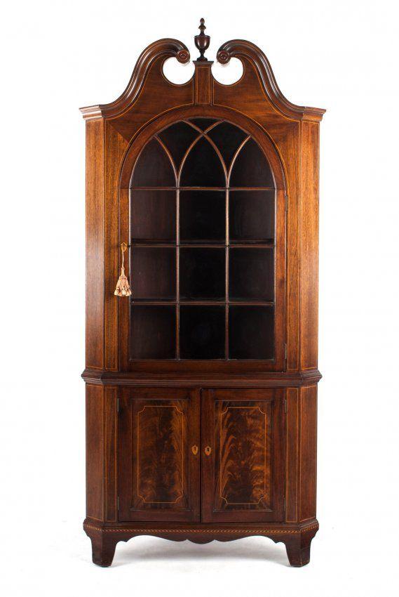 Potthast Bros. Mahogany Corner Cupboard.