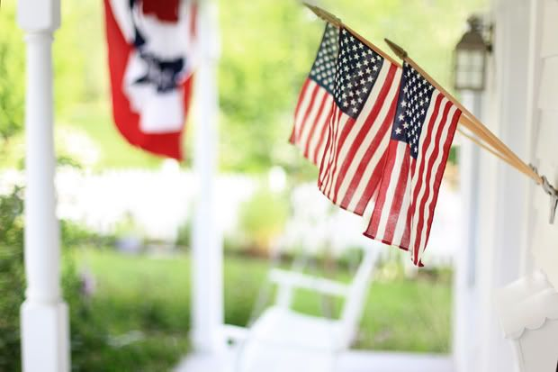 I love porches in the summertime, especially with flags flown proudly!