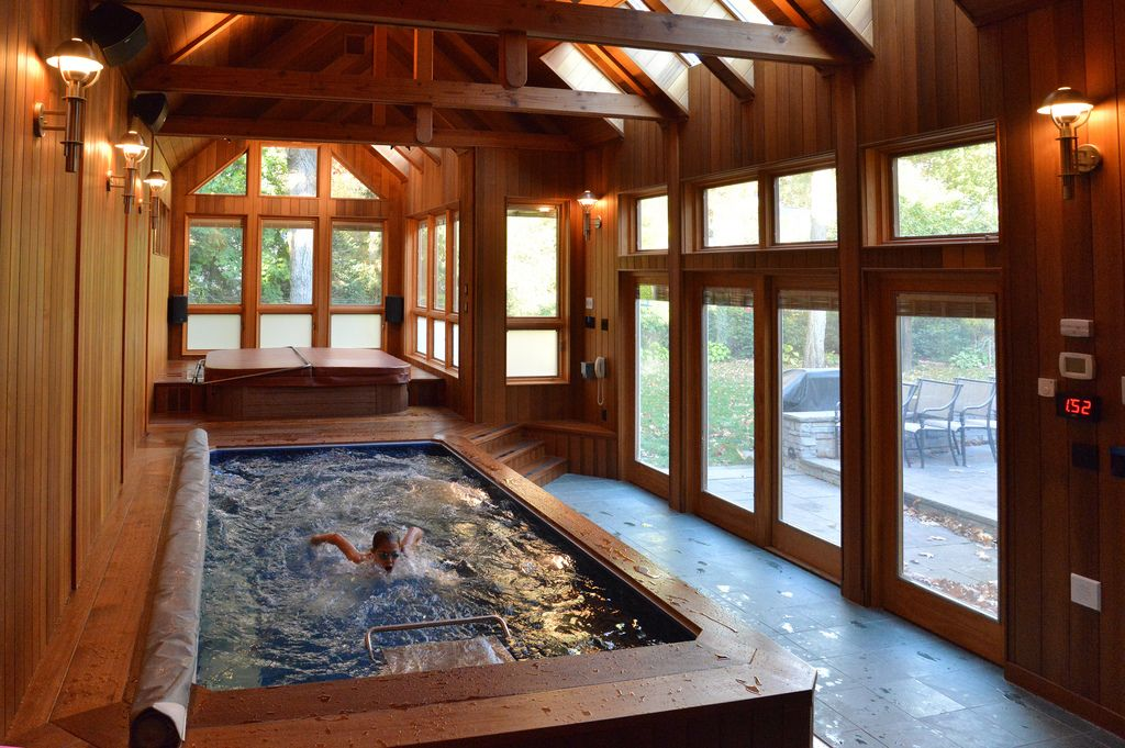 With Its Original Endless Pool®, This Sunroom Offers A Safe, Rustic  Environment For A Brisk Swim On An Autumn Day.