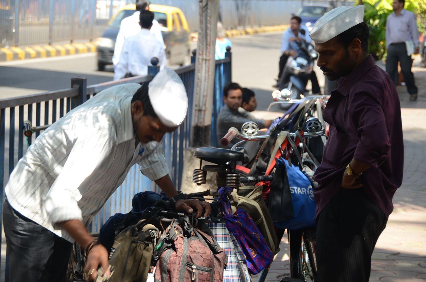 The Dabbawalas hard at work near Churchgate Station, Mumbai, India