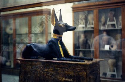 """ANUBIS, PROTECTOR OF THE DEAD & EMBALMING - son of Nephthys & Set. His wife is Anput. Usually portrayed as a half human half jackal or in full jackal form wearing a ribbon & holding a flail in the crook of its arm. He helped Isis mummify Osiris. With this connection, Anubis became the patron god of embalmers. He attends the  """"Weighing Of The Heart"""" & dictates the fate of souls. In this manner, he was a Lord of the Underworld, only usurped by Osiris."""