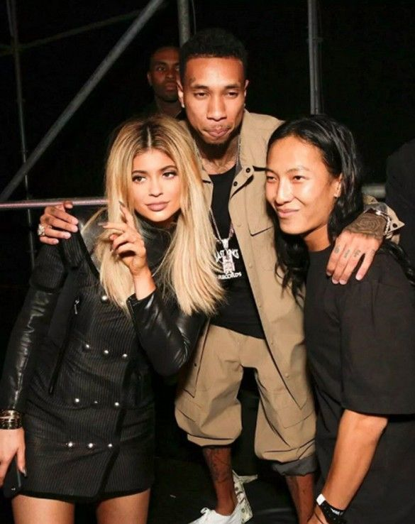 Kylie Jenner wears a black minidress with button detailing with Tyga and Alexander Wang