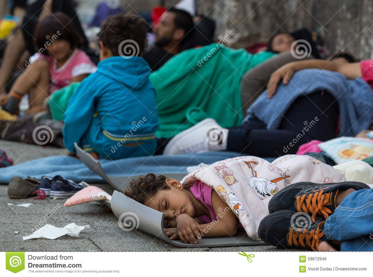 Refugee Child Sleeping At Keleti Train Station In Hungary - Download From Over 45 Million High Quality Stock Photos, Images, Vectors. Sign up for FREE today. Image: 58672949