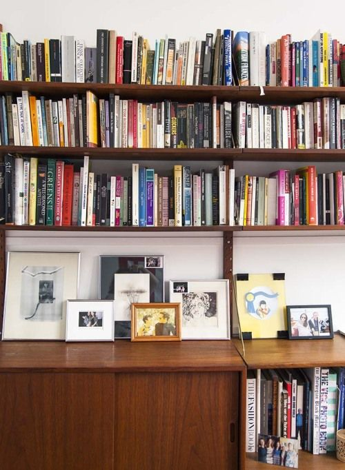 Library wall with prints/pictures