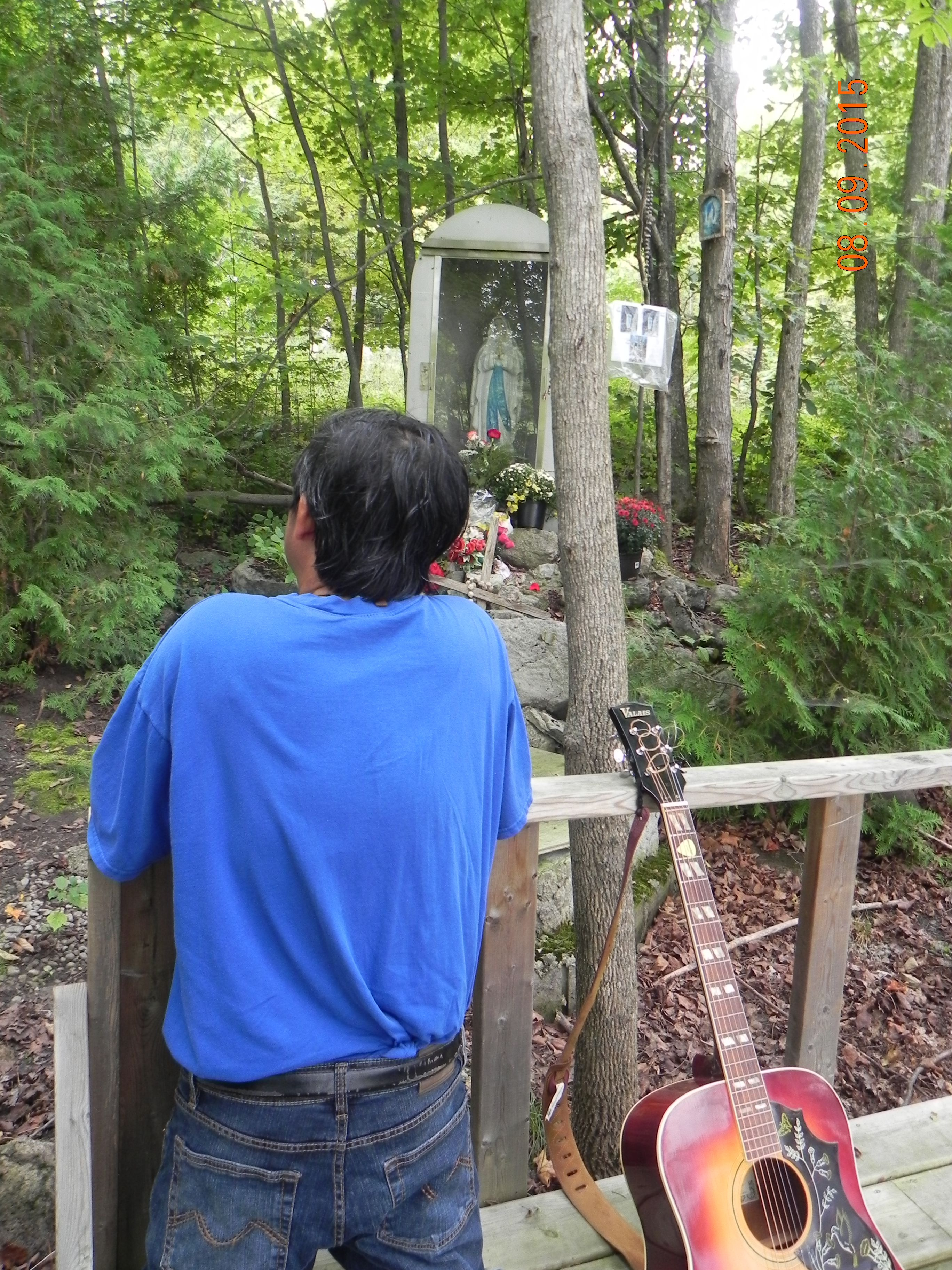 Praying at the Grotto