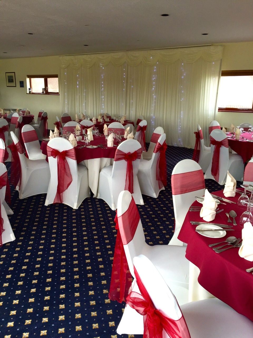 chair covers yeovil linen tufted ivory cover with burgundy organza sashes an backdrop and wincanton racecourse