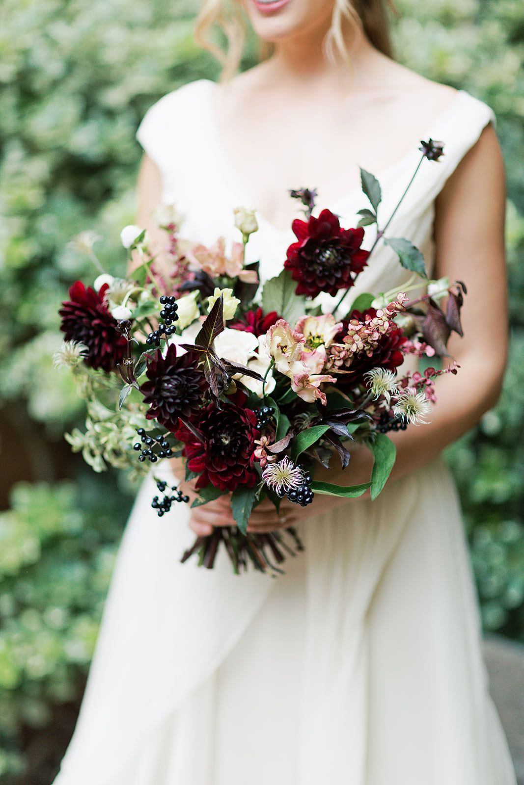 Deep red, burgundy and navy wedding colors perfect for a