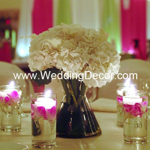 Wedding Centerpiece - hydrangea and calla lilies in a bow tie vase - votive candle accents with fuchsia orchids and small floating candles