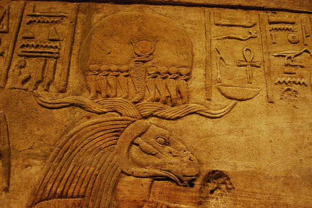 Detail from the shrine of king Taharqa. King Taharqa and the gods of Gematen (the temple at Kawa). Taharqa offers a loaf, a necklace, a pectoral and a figure of Maat (the symbol of cosmic order) to the ram-headed god Amun-Ra. Behind the god´s throne stand the goddesses Anuket Nethy, Satet and Anuket Ba. 25th dynasty.  Ashmolean Museum