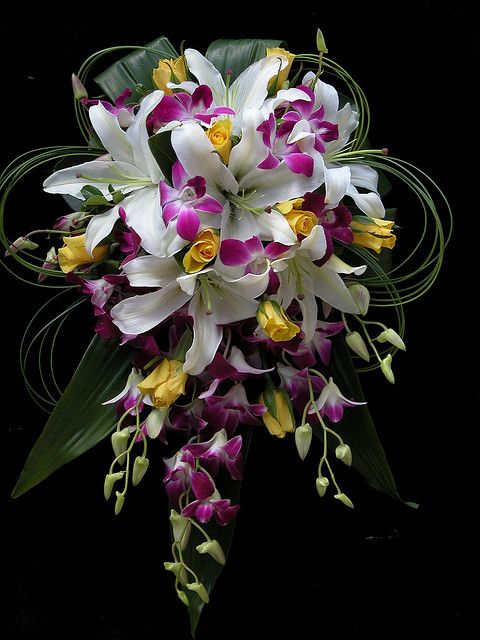 Cascading lilies yellow roses purple orchids by Bliss Floral, via Flickr