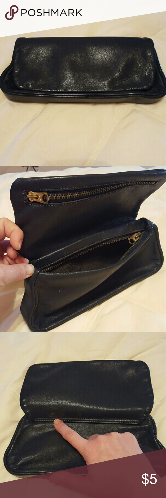 Small dark navy leather clutch. Unbranded but similar to Coach. Small wear marks as shown in photos. Bags Clutches & Wristlets