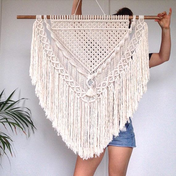 This gorgeous Jenny macrame is handmade with natural cotton rope. It features a grey stone centrepiece creating the perfect coastal vibe for any space! *Height- Top of timber to bottom of fringe approx 80cm * Width- From one end of timber to the other approx 90cm *Please know that #onehome