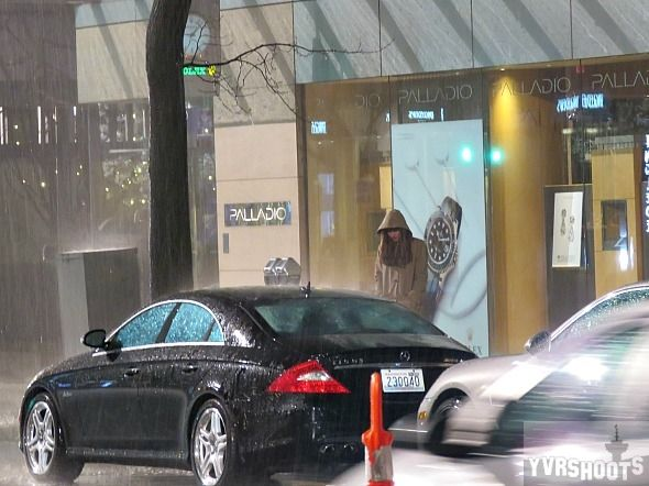 Dakota Johnson under a rain tower at Vancouver's Terminal Club Fifty Shades Scene(3/14/16) source:YVRSHOOTS More Pictures:FACEBOOK