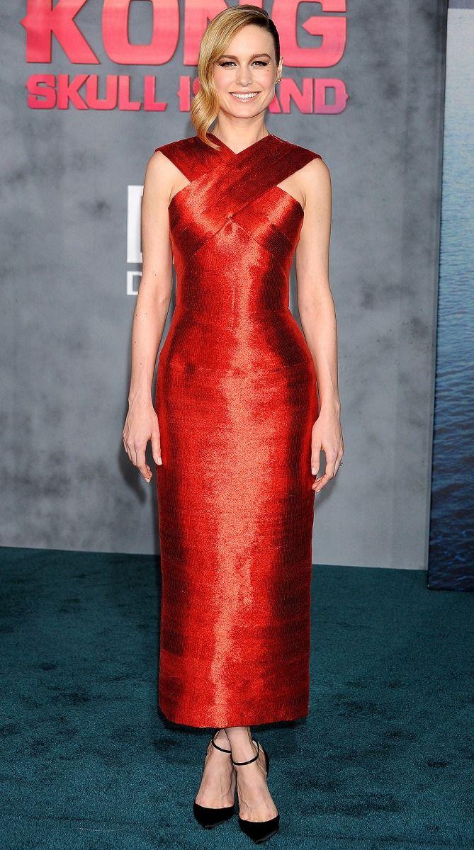 Brie Larson in a red Oscar de la Renta midi dress