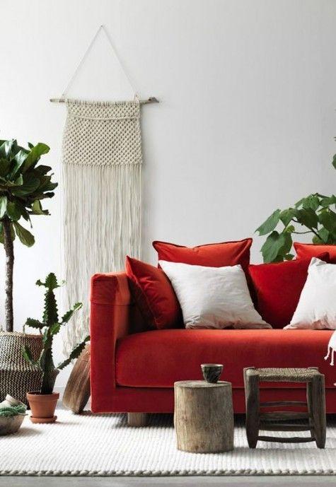 a bold orange velvet stockholm sofa for a boho chic living