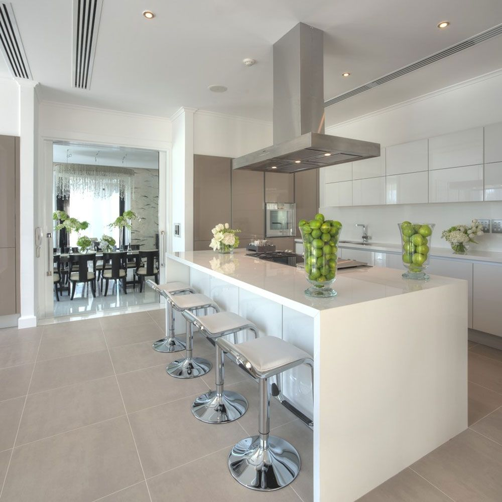 white modern kitchen breakfast bar island stools glass high gloss white kitchen with a pop of bright colour love this