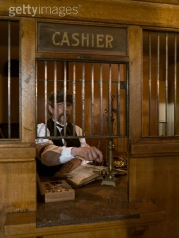 Old Fashioned Bank Teller Weighing Gold On Scale In 2019