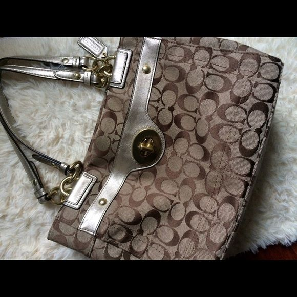 Coach signature print fabric handbag Coach signature print khaki color. 3 compartments. Great condition. No trades. Coach Bags