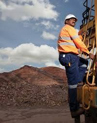 """Economy: In this image we see an Australian miner. Australia's largest export, or the item that they send most to another country to be used or sold, are minerals. He could be mining iron, diamonds, coal, silver, gold or copper because these are some on the main minerals Australia exports. Australia has even be nicknamed the """"Lucky Country"""" because they are so rich in minerals."""