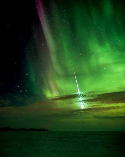Meteor streaking through Aurora Borealis !! Whoa