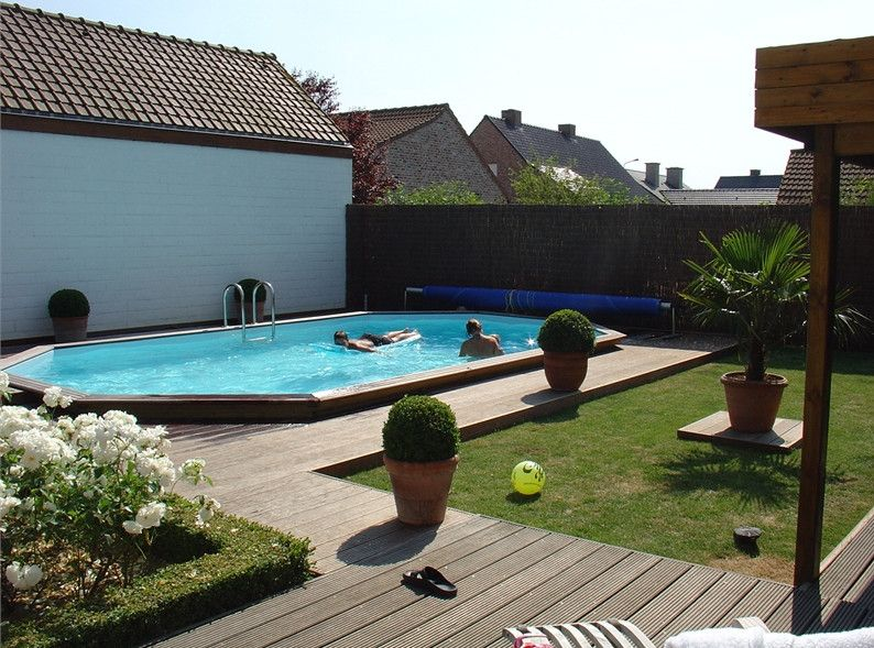 Pictures of semi inground pools with decks pools for In ground pool deck ideas