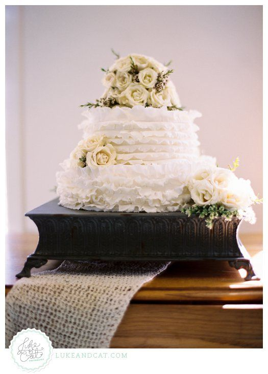 Ruffled cake with classic roses.