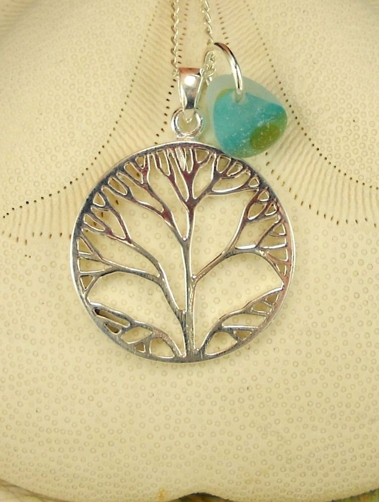 """Genuine English sea glass multi that I found during my recent trip to England! It is a beauty - perfectly-tumbled, lovely multi in shades of a landscape from blue at the top down to green at the bottom. It makes a lovely accent to this larger ALL Sterling Silver Tree-of-life pendant. The pendant which measures 1"""" by 1 1/3"""" and comes with a 18"""" Sterling Silver chain unless another length is requested at check out. I have 16"""" and 20"""" as well."""