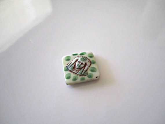 Vintage Egyptian Revival white, green and brown picasso King Tut cabochon. What a fabulous statement piece!  Quantity: 1  Size: 14mm    ITEM#: 1ERC-V8-16   http://lilczecht...